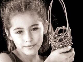 Laleena McCluer, La Jolla, holding her first juncus basket