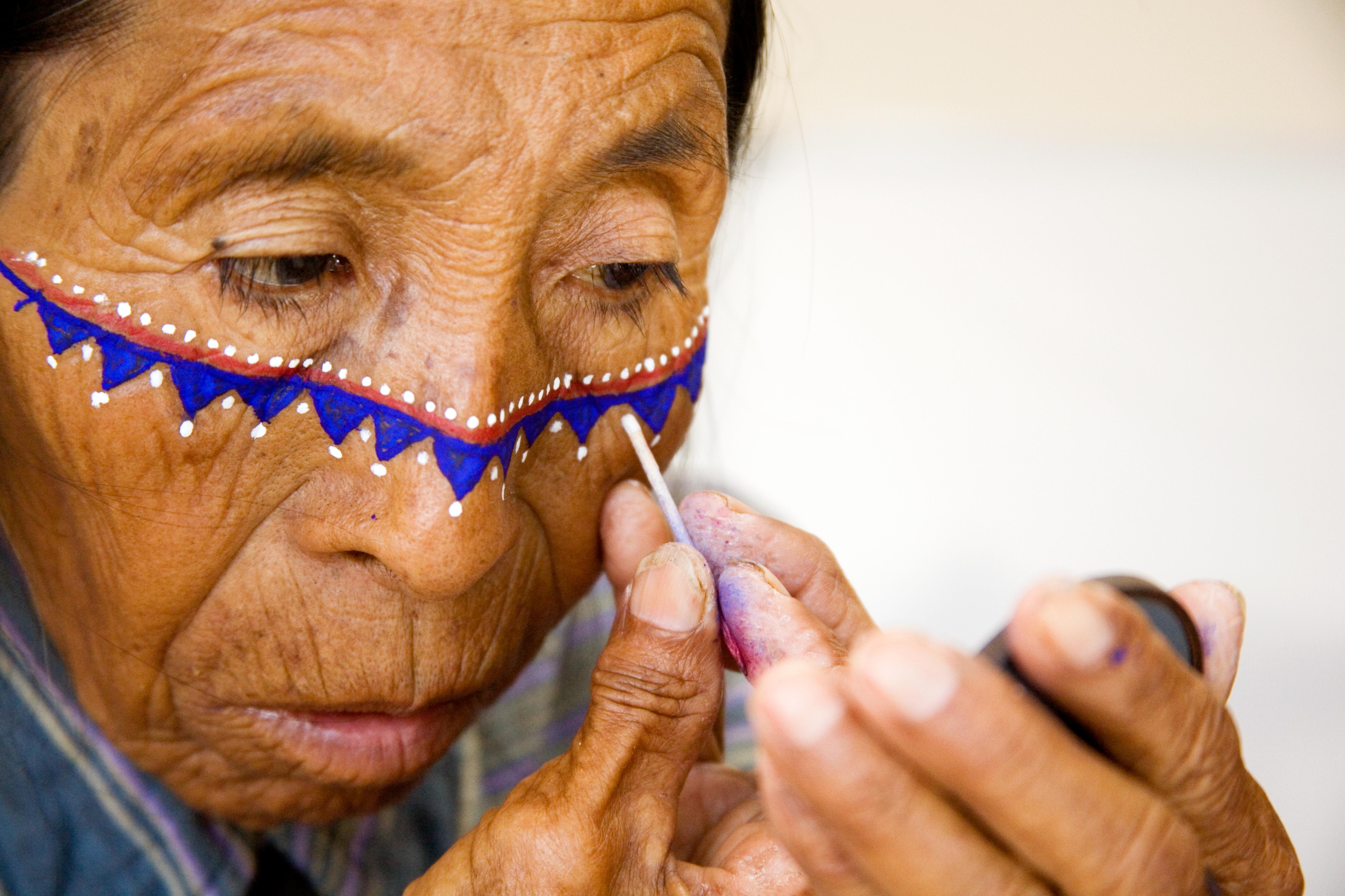 Angelita Torres applying face paint