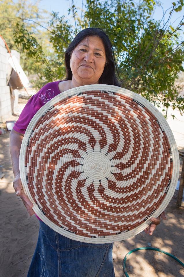 Panchita Moreno holds her snake basket